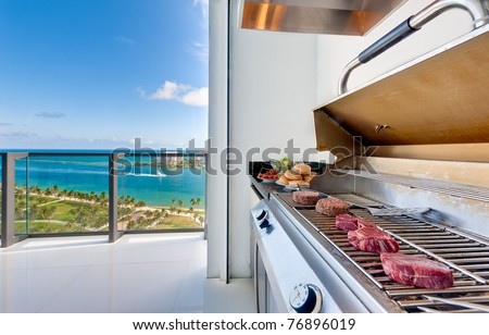 View of a barbecue in an luxury terrace with ocean view.