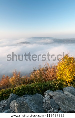 View of a beautiful misty morning on the top of the hill.