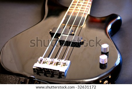 view of a black bass guitar close up of strings stock photo 32631172 shutterstock. Black Bedroom Furniture Sets. Home Design Ideas
