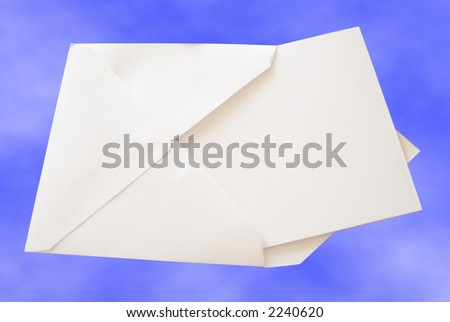 View of a blank note card in a white envelope on the sky background