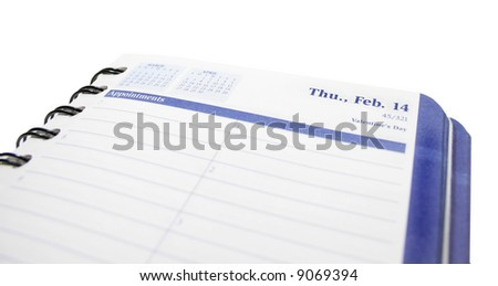 View of a blank page in a daily planner with the valentine's day date