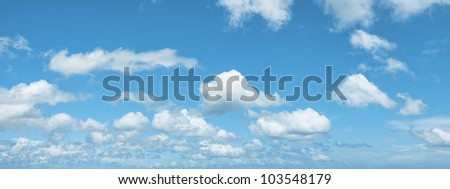 View of a blue cloudy sky. Panoramic composition in high resolution.