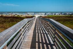 View of a boardwalk leading to East Beach Galveston Island Texas.