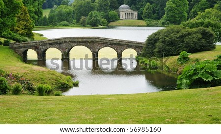 View of a Bridge and Lake in an English Landscape Garden