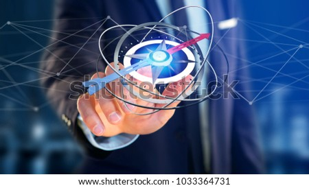 View of a Business man holding a navigation compass - 3d rendered #1033364731
