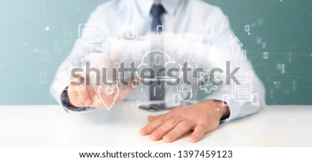 View of a Businessman holding a Cloud of multimedia icon 3d rendering #1397459123