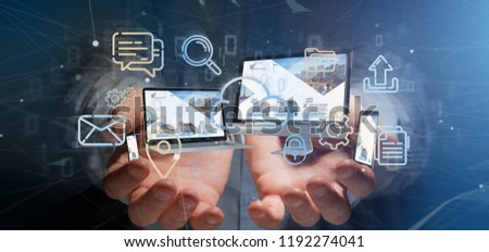 View of a Businessman holding a Devices connected to a cloud multimedia network 3d rendering #1192274041