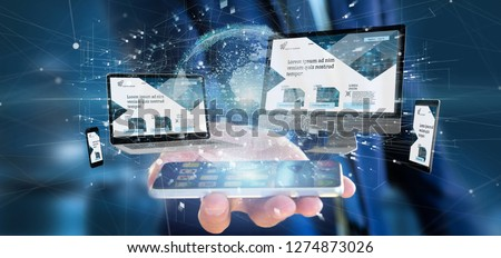 View of a Businessman holding a Devices connected to a global business network 3d rendering #1274873026
