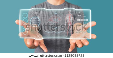 View of a Businessman holding a Futuristic template interface hud #1128085925