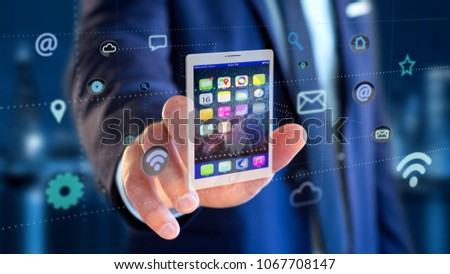 View of a Businessman holding a tablet surrounding by app and social icon - 3d render