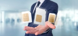 View of a Businessman holding Different size of a smartphone sim card