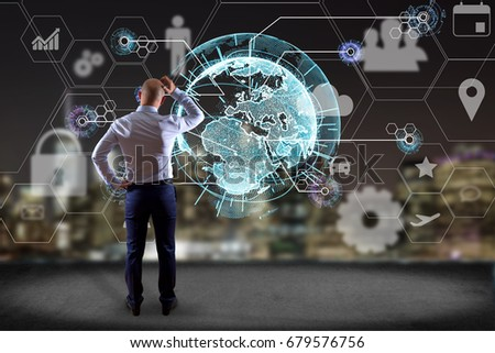 View of a Businessman in front of a wall with an International business network connection displayed on a futuristic interface with technology icon and sphere globe - Worldwide business concept #679576756