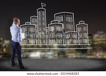View of a Businessman in front of a wall with Hand drawn city center displayed on a futuristic interface - Travel concept #1014468283