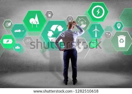 View of a Businessman in front of a wall with Technology ecologic interface  #1282510618