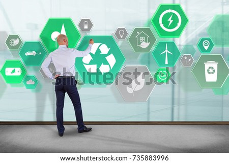 View of a Businessman in front of a wall with Technology ecologic interface  #735883996
