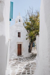 View of a chapel from a narrow street in Hora (also known as Mykonos Town), Mykonos, Greece.