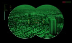 view of a city in the crosshairs night vision device of terrorism