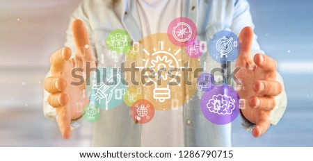 View of a Cloud of colorfull start up icon bubble with data Businessman holding a binary 3d rendering #1286790715