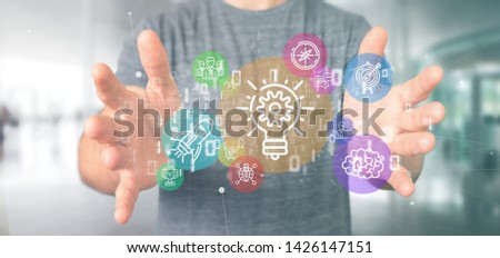 View of a Cloud of colorfull start up icon bubble with data Businessman holding a binary 3d rendering #1426147151
