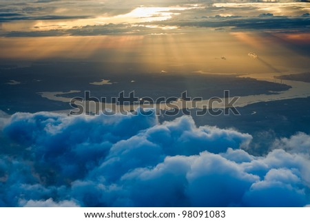 view of a clouds and land on sky at sunset on the plane at Singapore