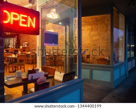View of a coffee house interior from the outside at nighttime in winter #1344400199