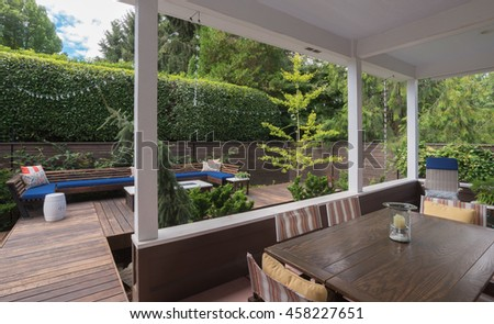 View of a contemporary conversation bench on a wooded deck as seen from a porch. #458227651
