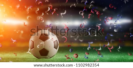 View of a 3d rendering Football ball on the field of a world cup stadium with  streamers