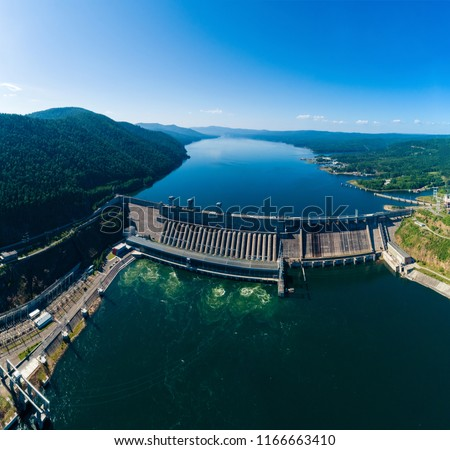 View of a dam of hydroelectric power station in Russia on the Yenisei River, panorama, shooting from air