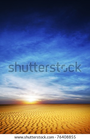 View of a desert at sunset time