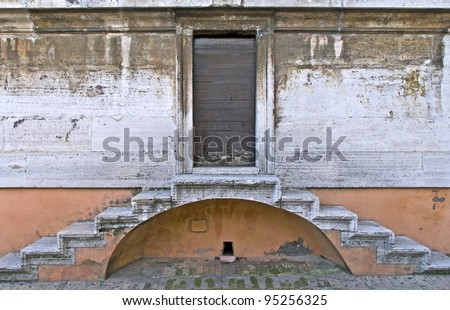 View of a door and two symmetric stairs