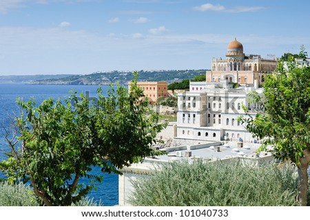 View of a eastern style villa and some white houses on the southern coast of Italy. Santa Cesarea Terme.