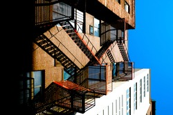 View of a fire escape staircase on a building, New York City.