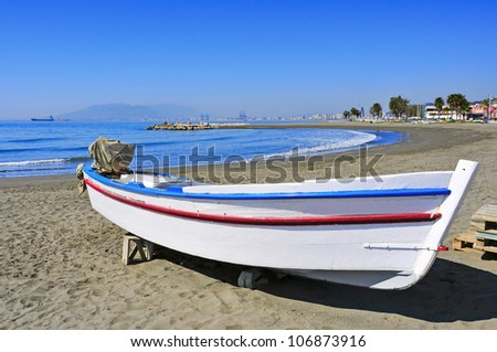 view of a fishing boat in Pedregalejo Beach in Malaga, Spain - stock photo