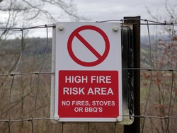 View of a Generic Sign Reading 'High Fire Risk Area'