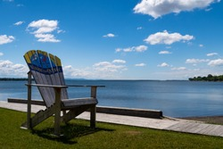 View of a giant wooden chair in front of the lake Champlain, at Venise-en-Quebec, Canada