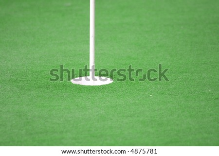 View of a golf hole, bright green grass