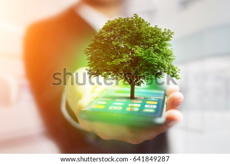 View of a Green tree going out of a smartphone - Ecology concept #641849287