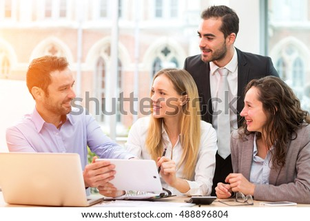 View of a Group of business people working together at the office - Shutterstock ID 488896804