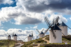 View of a group of old windmills, located on a hill in the town of Consuegra (Spain), on the traditional route of the Cervantes mills (Don Quixote).