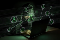 View of a Hacker man in the dark using computer to hack data and information system