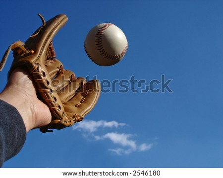 View of a hand in baseball glove reaching out to make the catch