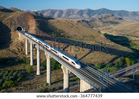 Shutterstock view of a high-speed train crossing a viaduct in Purroy, Zaragoza, Aragon, Spain. AVE Madrid Barcelona.