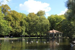 View of a Kiosk and lake in the Saint Stephen's Green park in Dublin, Ireland