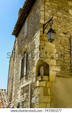 View of a lane with an ancient palace in Gordes (Provence, France) in summer.