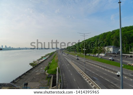 View of a large beautiful city in the early morning. Kiev. Ukraine.View from the Metro Bridge #1414395965