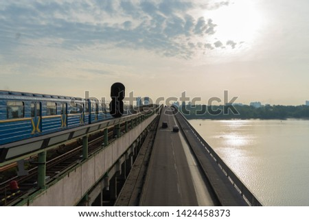 View of a large beautiful city in the early morning. Kiev. Ukraine.View from the Metro Bridge #1424458373