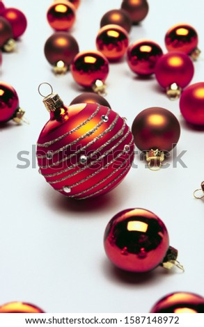 View of a large Christmas ornament amongst smaller ones