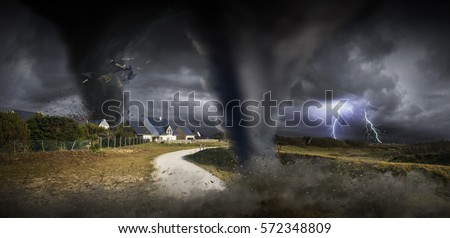 View of a large tornados destroying the landscape and city