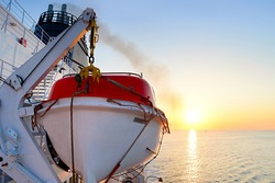 View of a lifeboat on a cruise ship at sunrise