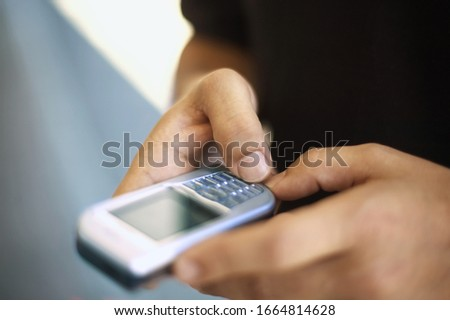 View of a man using his cell phone